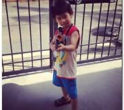 Kids playing with toy gun