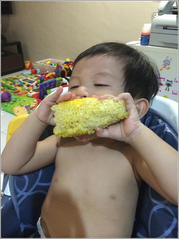 Ayden eat corn